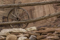 Old wagon wheel an by an wooden fence Stock Image