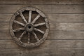 Old wagon wheel on wooden wall Royalty Free Stock Photo