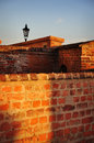 Old wall architecture walls of a castle in red bricks background Royalty Free Stock Images