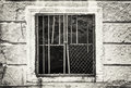 Old wall with barred window, black and white Royalty Free Stock Photo