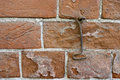 Old wall brick and metal hook Stock Photography