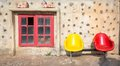 Old wall with colourful chair and window red yellow chairs redwindow Royalty Free Stock Photo