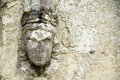 Old wall detail carved head relief Stock Photos