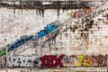 Old wall with murals and graffito. Stairway. Rome, Italy Royalty Free Stock Photo