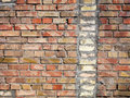 On an old wall of red bricks a separated vertical fragment of the old silicate brick Royalty Free Stock Photo