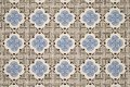 Old wall with traditional Portuguese decor tiles azulezhu in blue and brown tones on a beige background. Royalty Free Stock Photo