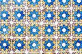 Old wall with traditional Portuguese decor tiles azulezhu in blue,yellow and brown tones. Royalty Free Stock Photo