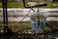 Old water bucket in the village Royalty Free Stock Photo