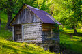 Old water mill closed in the forest Stock Image
