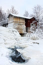 Old water mill winter scenery frozen near icy snowy Royalty Free Stock Image