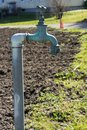 Old water pipe, Faucet with nature brown earth background A old rusty water tap in garden. Royalty Free Stock Photo