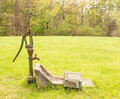 Old water pump and faucet Royalty Free Stock Photo
