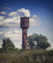 Old water tower on the background of the natural landscape Royalty Free Stock Photo