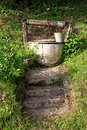 Old water well in green scenery Royalty Free Stock Photography