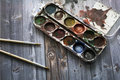 Old watercolor paints and brushes Royalty Free Stock Photo