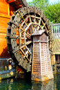 Old watermill mill house and wooden water wheel Stock Photos