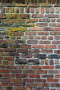 Old weathered brick wall discolored with age and time sizes shapes of bricks from Royalty Free Stock Images