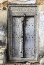 Old weathered carved traditional zanzibarian door of building in bagamoyo tanzania Stock Image