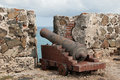Old weathered dutch cannon stands guard over sea as reminder bygone era Stock Photos