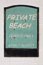 Old weathered private beach sign an wooden for a Stock Images