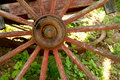 Old weathered red wagon wheel a Stock Photos