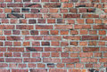 Old weathered stained red brick wall Royalty Free Stock Photo
