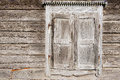 Old weathered traditional wooden window shutters. Royalty Free Stock Photo