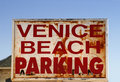 An old weathered Venice Beach parking sign Royalty Free Stock Photo