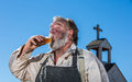 Old west drunk drinks a bottle of liquor Stock Photos