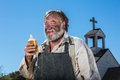 Old west drunkard drinks a bottle of alchohol Royalty Free Stock Image