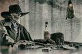 Old West Poker Playing Skeleton Gun