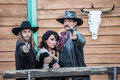 Old west trio points guns at you Royalty Free Stock Images