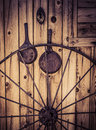 Old western cabin with wagon wheel and rustic objects Stock Image