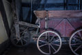 The old wheel of a cart in barn Royalty Free Stock Photo