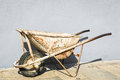 Old wheelbarrow back yard Stock Image
