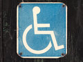 Old wheelchair sign on a wooden wall Royalty Free Stock Images