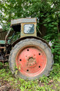 Old wheeled abandoned tractor. Big wheel. Royalty Free Stock Photo