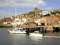 Old whitby north yorkshire st mary s church stands high above the town and the lifeboat station at england uk Royalty Free Stock Photo