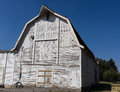 Old white farm barn a classic in bozeman monatana with hayloaf and clapboard boards Stock Photos