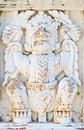 The old white garuda statue on wall in temple thailand Stock Photos