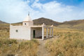 Old white mausoleum in south morocco near ikniwn village Royalty Free Stock Photography