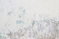 Old white paint texture peeling off concrete wall Royalty Free Stock Photo