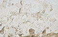 Old white painted plaster wall with cracks and stains Royalty Free Stock Photo