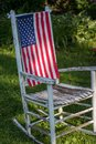 Old white rustic rocking chair with United States flag Royalty Free Stock Photo