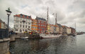 Old white ship in Nyhavn at cloudy day, Copenhagen, Denmark, August of 2014 Royalty Free Stock Photo