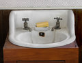 Old white sink and taps. Royalty Free Stock Image