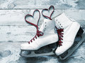 Old white skates for figure skating with a hearts of laces Royalty Free Stock Photo