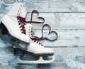 Old white skates for figure skating with a hearts of laces