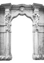 Old white stone entrance with statues that support the columns. Royalty Free Stock Photo