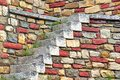 Old White Stone Stairs and multicolored Stonework Wall Royalty Free Stock Photo